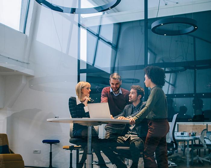 career management program administrators gathered around a laptop