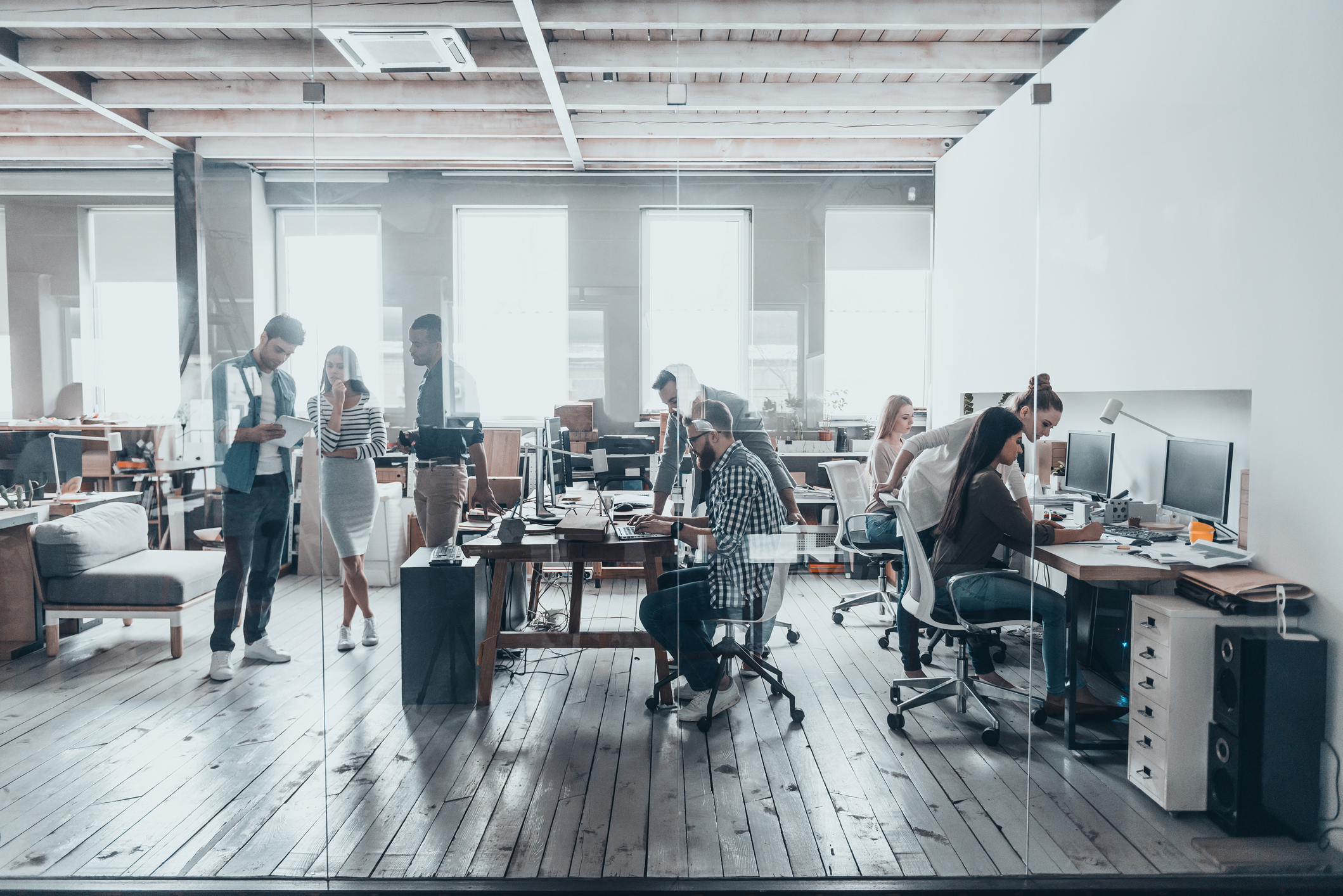 employees in an open work environment working in pairs